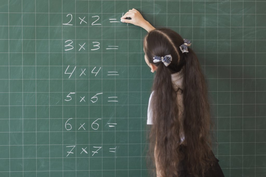 Pricing for The Tutor Team - Experience Online Tutors - Girl answering equations